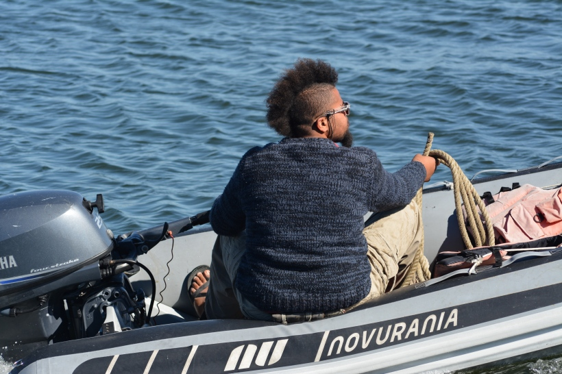 He has a backup plan, if the motor goes out in sails with hair. Photo by Mike Hartley