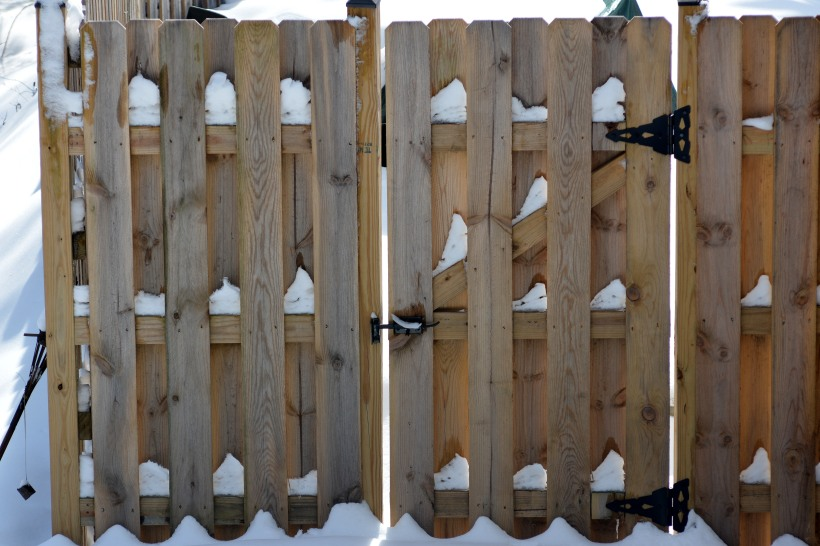 Snow on Fence Photo by Mike Hartley