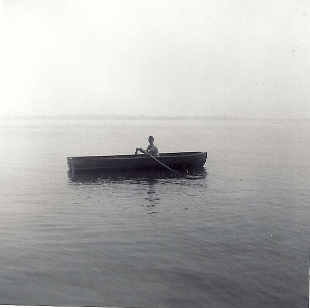 My Aunt and Uncle's rowboat in 1969 with me at the helm.  Photo by Shirley Hartley