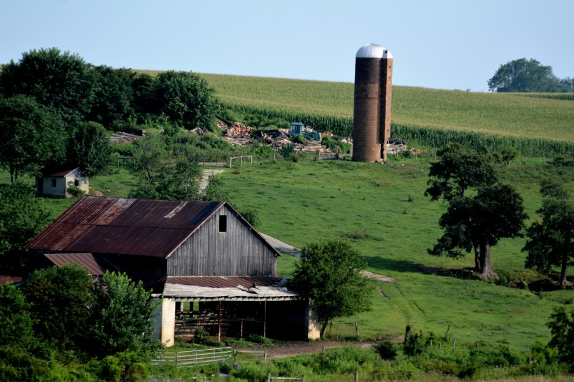 Silo, barn and rolling hills. Photo by Mike Hartley