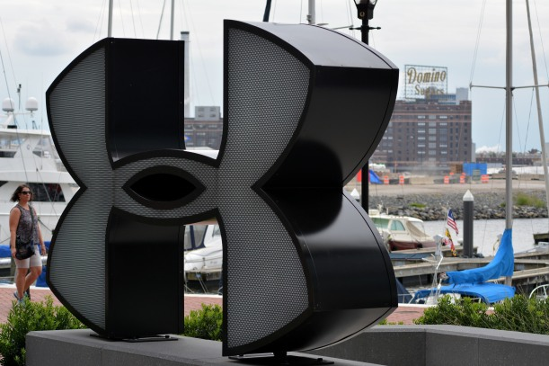 Two signs of Baltimore. Domino Sugar behind the Under Armour store logo. Photo by Mike Hartley