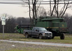 Combine along Rt 99. Seems a bit early to me but hell its been warm.  Photo by Mike Hartley