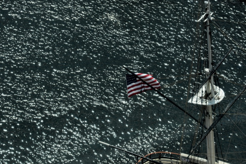 The flag over the USS Constellation in the Inner Harbor Baltimore. Photo by Mike Hartley