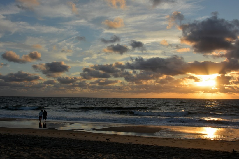 Couple looking at sunrise. Photo by Mike Hartley