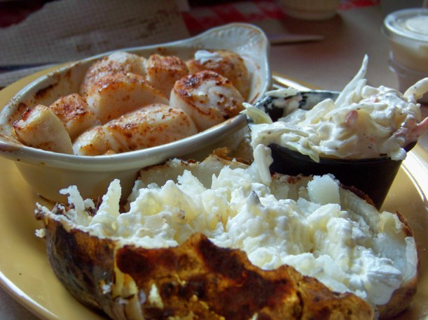 Scallops, slaw and baked potato w/sou cream. Photo by Mike Hartley